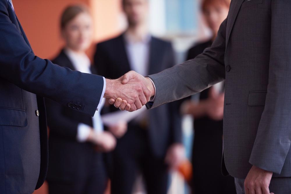 two businessman handshake.jpeg